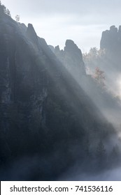 Misty rocks in sunlight