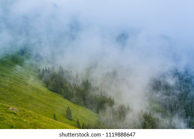 Misty scenery and rain in the Alps in summer