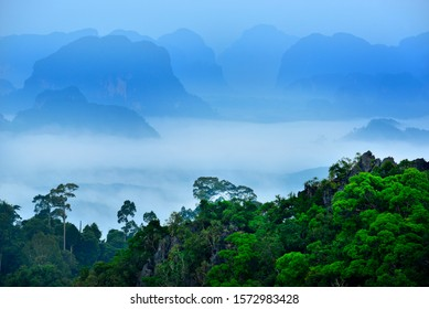 misty sea over the rain forest and limestone mountain of Krabi Province, Thailand