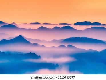 misty silhouettes of far mountains