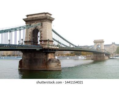 Misty stone bridge in Budapest.
