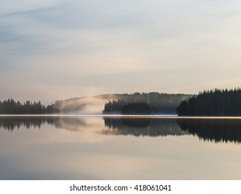 Misty summer morning in Finnish lake district.
