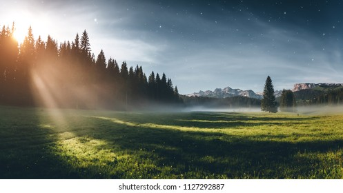 Misty summer night in the Durmitor National park. Location place village Zabljak, Montenegro, Balkans, Europe. Scenic image of travel destination. Magic astrophotography. Discover the beauty of earth.