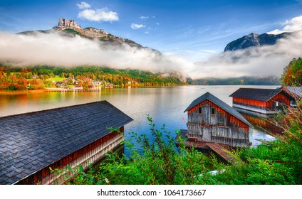 Misty and sunny morning on Altaussee village. Sunny autumn scene in the morning. Location: village Altaussee, Liezen District of Styria, Austria, Alps. Europe.