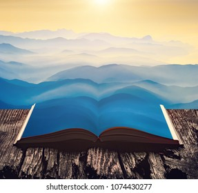 Misty sunrise above the mountain valley on the pages of an open magical book. Majestic landscape. Nature and education concept.