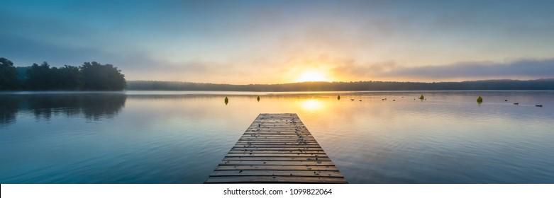 Misty sunrise at a lake in Mecklenburg Vorpommen in Germany