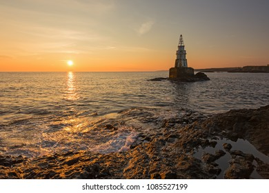 Misty sunrise of the lighthouse in Ahtopol, Bulgaria.
