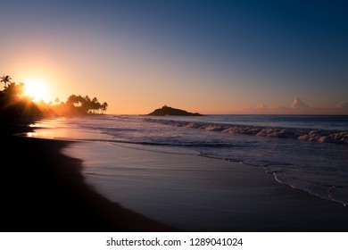 Misty sunrise at Mirissa Beach, southern Sri Lanka.
