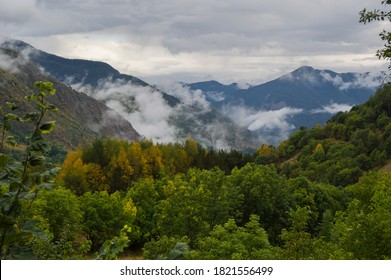 Misty valley and foggy mountains on a gloomy and cloudy day. Wild forests in Catalan Pyrenees, in Spain. Unarre valley in Alt Pirineu natural park.