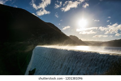A misty view over Caban Coch dam & reservoir in the Elan Valley. Wales, UK