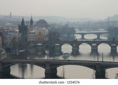 Misty view of Prague's bridges (including Charles Bridge)