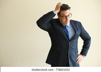 Misunderstanding businessman clutching head