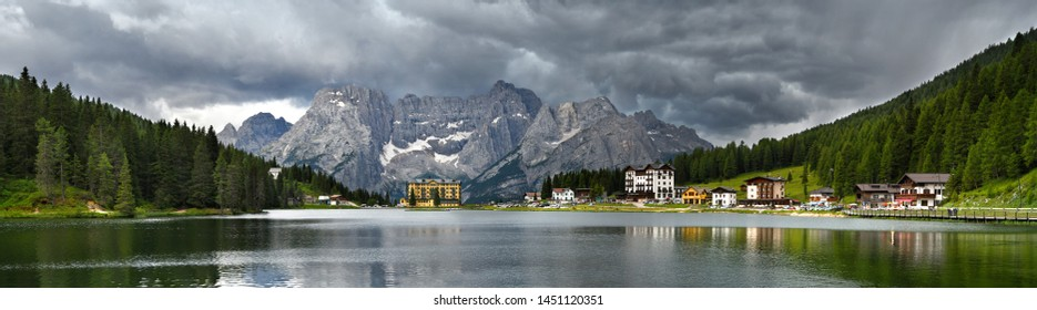 Misurina (BL) Italy - July 2019: Beautiful Panorama at Misurina lake with Sorapiss Dolomitic Group on background and dramatic cloudy sky. Sexten Dolomites near Cortina d'Ampezzo, Italy. Europe.