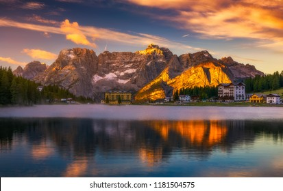 Misurina Lake in the Dolomites mountains in Italy near Auronzo di Cadore on a cloudy day, Sorapiss mountain in the background. South Tyrol, Dolomites, Italy.