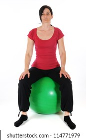Mit adult woman with a fitness ball