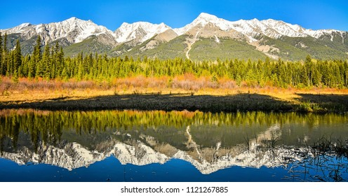 Mitchell Mountain Range reflected in Dog Lake Kootenay National Park, British Columbia, Canada. Spring Mountain Landscape.