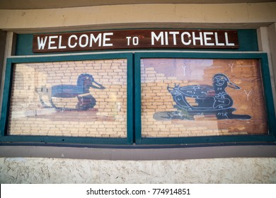 Mitchell, South Dakota, USA - July 2, 2017: Welcome sign to Michell includes instruction of making duck of corn on the cob