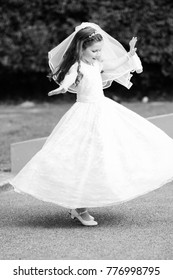 MITCHELSTOWN, IRELAND - May, 28, 2016: Little girl in a white dress on her First Holy Communion day