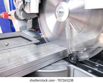 Miter saw. Cutting of aluminum profile. Shavings.