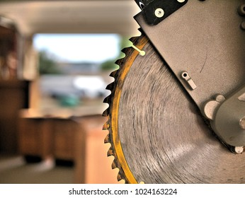 Miter saw tool blade up close for cutting lumber and carpentry.