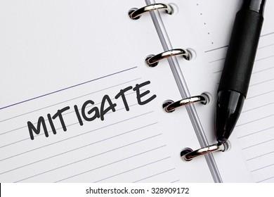 MITIGATE word written on notebook