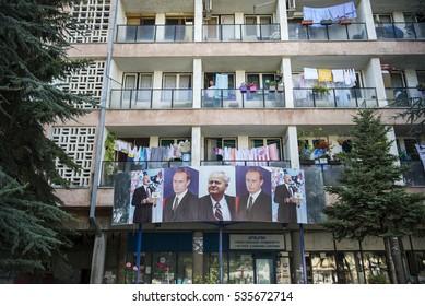 Mitrovica, Kosovo - August 22, 2014. The photos of Slobodan Milosevic, Vladimir Putin and Alexander Lukashenko are seen on a tenement in northern Mitrovica, inhabited by the Sebian population.