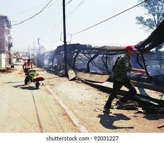 MITROVICA, KOSOVO - JUNE 28: Ethnic Albanian Kosovars loot and burn Serb and Gypsie homes and businesses as part of a large-scale revenge in Mitrovica, Kosovo, on Monday, June 28, 1999.