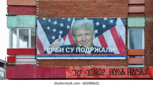 "MITROVICA,KOSOVO- MARCH 13,2017: year.President Donald Trump on the billboard in the northern part of  Kosovska Mitrovica in which live Serbs.Translation ""Serbs supported""."