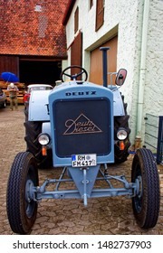"""Mitteleschenbach, Bavaria / Germany - JULY 22, 2018: annual harvest festival """"Mitteleschenbacher Ganswosnfest"""". Demonstration of rare equipment tractors, cars and motorcycles"""