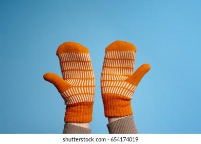mitten gloves on hands
