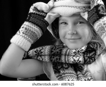 Mittens, Scarf and Knit Hat on Young Girl