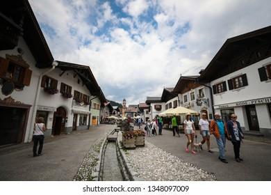 Mittenwald, Bavaria, Germany - July 9, 2018: Mittenwald is a town amid the Alpine Karwendel mountain range. It's known for its colorful painted houses and its violin-making history.