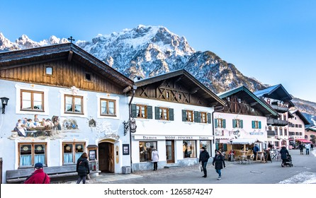 Mittenwald, Germany - December 15: people in the famous old town of mittenwald - karwendel mountains at the background, bavaria/germany on december 15, 2018