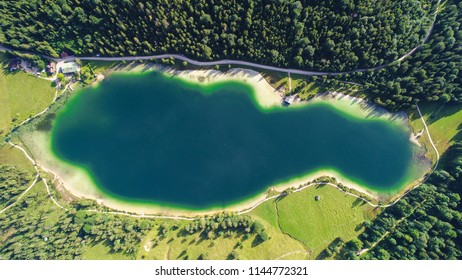 Mittenwald, Germany - July 29, 2018: An aerial drone view of a the Ferchensee Lake in the Bavarian Alps.