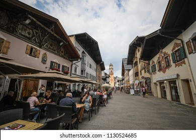 Mittenwald, Germany - July 8, 2018: A view of the historic downtown part of Mittenwald, a Bavarian Alpine village in the south with a view of the St. Peter and St. Paul Church.