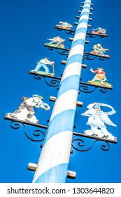 Mittenwald - Germany, November 16: typical bavarian maypole with paintings in front of blue sky in mittenwald, bavaria/germany on november 16, 2018