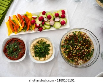 A mix of arabic food together with fresh vegetables