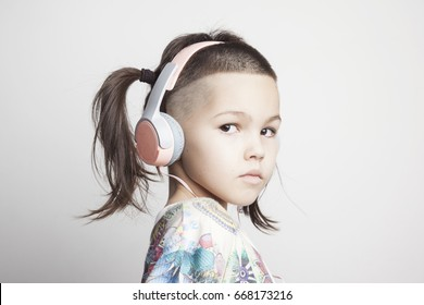 Mix asian girl with modern haircut and headphones