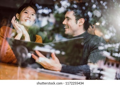 mix asian woman caucasian men People Meeting Friendship Togetherness and happiness enjoy at Coffee Shop Concept casual relax moment