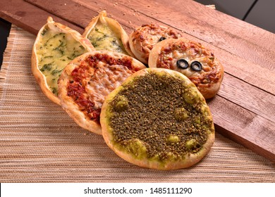 Mix Baked Fatayer and Manakeesh Pastry Styled and Garnished on a Plate
