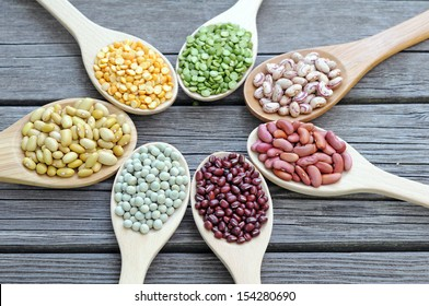 mix beans in wooden spoon on grunge background