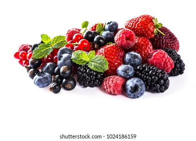 Mix berries isolated on a white. Ripe blueberries, blackberries, raspberries, currants and strawberries with mint. Berries and fruits with copy space for text. Background berries.