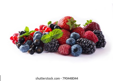 Mix berries isolated on a white. Various fresh summer berries on white background. Berries and fruits with copy space for text. Background berries. Blueberries, blackberries, currants, raspberries