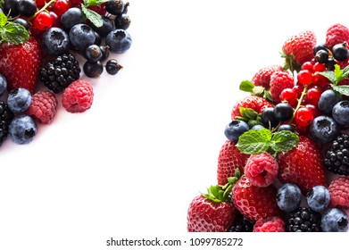 Mix berries on a white background. Ripe red currants, strawberries, blackberries, blueberries, blackcurrants, raspberries, mint leaves on white background. Top view. Fruits with copy space for text
