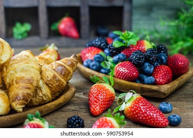 Mix Berries strawberries, blueberries, blackberries on Wooden Background. Summer Organic Berry over Wood. Agriculture, Gardening