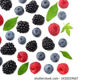 mix of blueberries, blackberries, raspberries isolated on white background. top view with copy space