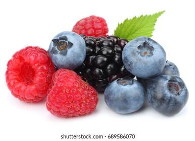 mix of blueberries, blackberries, raspberries isolated on white background