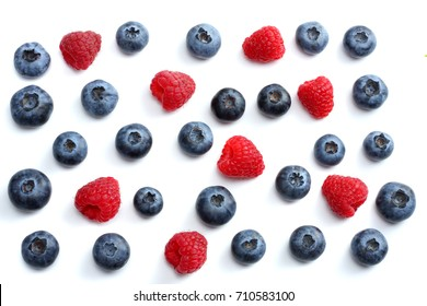 mix of blueberries, raspberries isolated on white background. top view