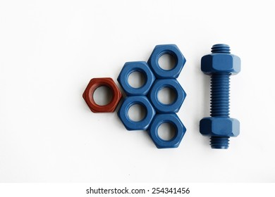 Mix bolt and nut in blue coated and red coated isolated on white background