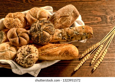mix of bread on wooden table